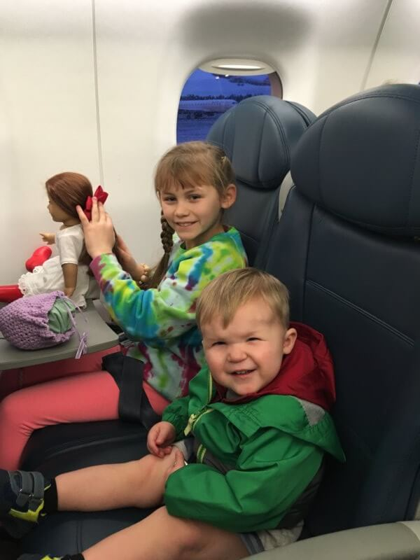 kids are excited to be on a plane